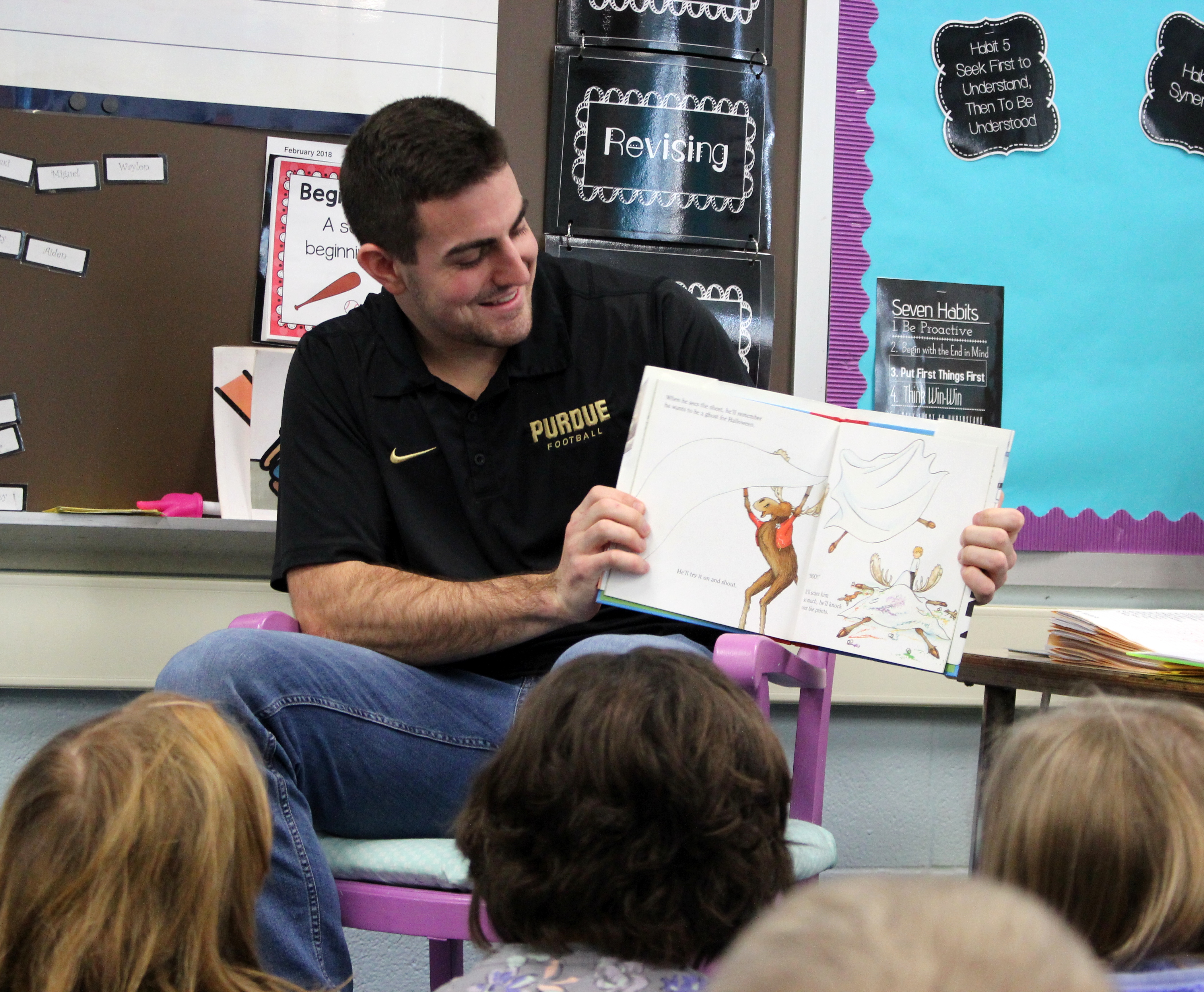 David Blough reads to students at Hershey Elementary