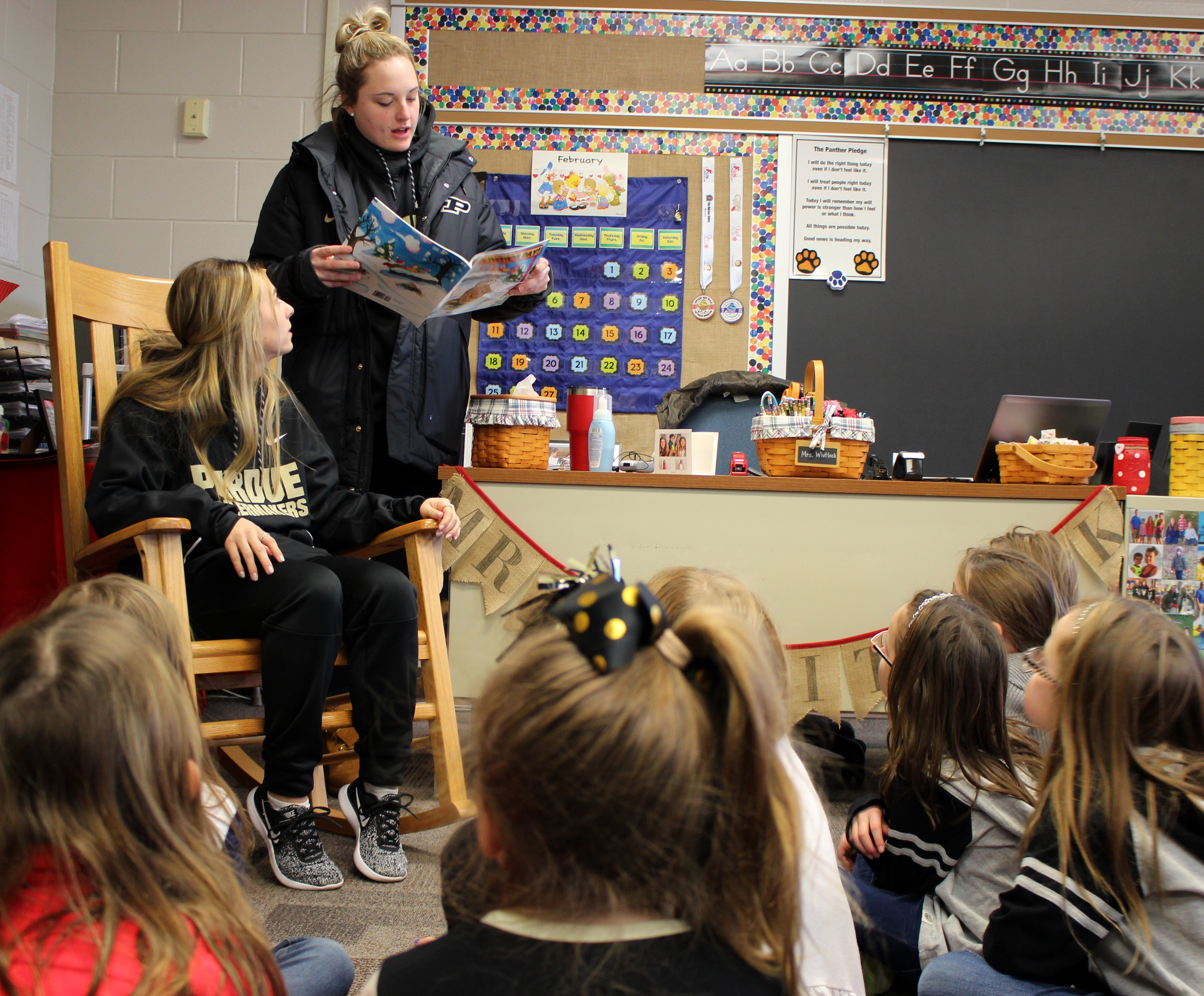 Purdue softball players read a story to students at Hershey